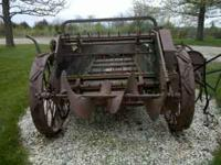 Antique manure spreader used as yard art. Call for any