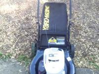 yard man push lawn mower with bagger...asking 150.00