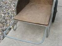 I am selling this manure/yard cart. Only used for dirt