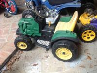 Power wheels 12 volt tractor $75 (needs battery) I have