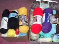 Two boxes of assorted colors of yarn. Full skeins and