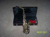YAS -23 ALTO SAX . INSTRUMENT IS IN YAMAHA HARD CASE.