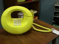 Classic mid-century modern style phone. Instantly