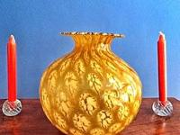 I have an abstract yellow glass flower vase.