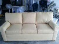 Sofa is like new in great shape bright yellow no stains