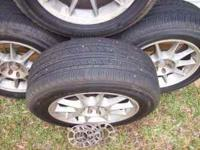 "This is a set of 4 Yokohama 15"" tires with rims taken"