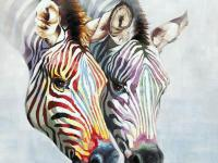 A pair of zebra heads painted in soft tones of red,