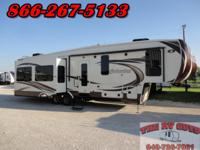 This luxurious and roomy 36ft five slide fifth wheel is