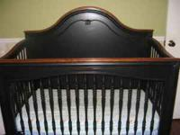 Young Americababy crib from Storkland. Crib has an