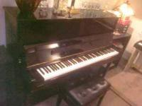 Beautiful ebony Young Chang/Bergman studio piano with