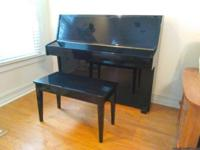 Give this beautiful high gloss ebony compact upright