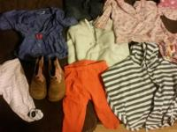 A variety of sizes of little girls clothes and boots