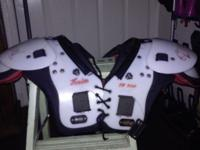 1 medium size football shoulder pads 100 to 120 pounds