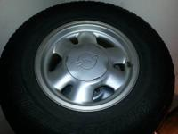 nice set of factory wheels with tires from 2002 gmc