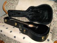 I am offering up my Zager ZAD 20 Black Lacquer Acoustic