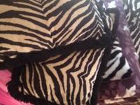 One white throw, 1 zebra throw,  mini chest,