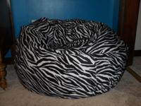 This is an extremely cute zebra print bean bag. Great