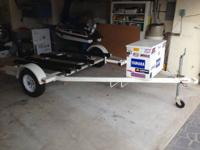 The trailer is a Zieman double with a lockable box,