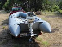 25 HP Johnson Outboard and Zodiac  Boat is in terrific